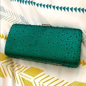 Elegant emerald green evening clutch with chain
